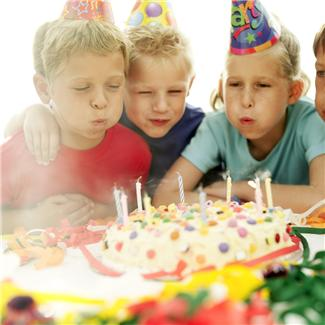 Blowing out candles as a 10th birthday party
